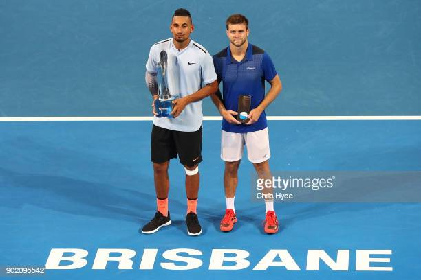 Nick Kyrgios of Australia and Ryan Harrison of the USA hold the winners trophy after the Men's Final match against during day eight of the 2018...