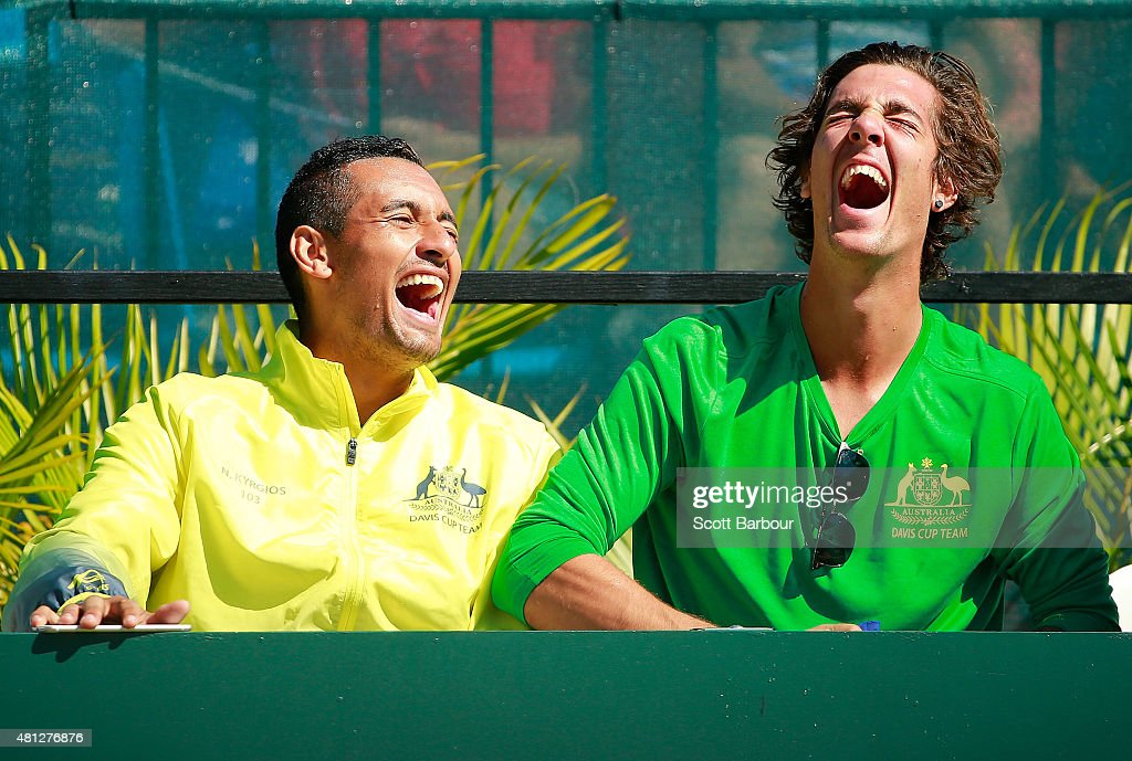 Nick Kyrgios of Australia and Thanasi Kokkinakis of Australia laugh as they watch the reverse singles match between Sam Groth of Australia and Mikhail Kukushkin of Kazakhstan during day three of the Davis Cup World Group quarterfinal tie between Australia and Kazakhstan at Marrara Sporting Complex on July 19, 2015 in Darwin, Australia.