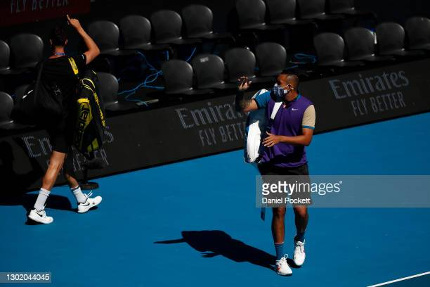 Nick Kyrgios of Australia and Thanasi Kokkinakis of Australia walk onto Margaret Court Arena ahead of their Men's Doubles second round match against...