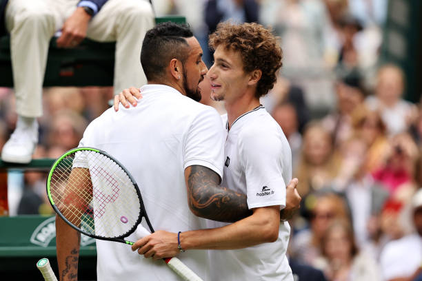 Nick Kyrgios of Australia and Ugo Humbert of France embrace at the net after their Men's Singles First Round match Men's Singles First Round match...