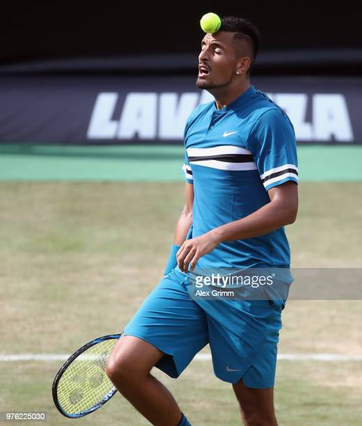 Nick Kyrgios of Australia balances a ball on his head during his match against Roger Federer of Switzerland during day 6 of the Mercedes Cup at...