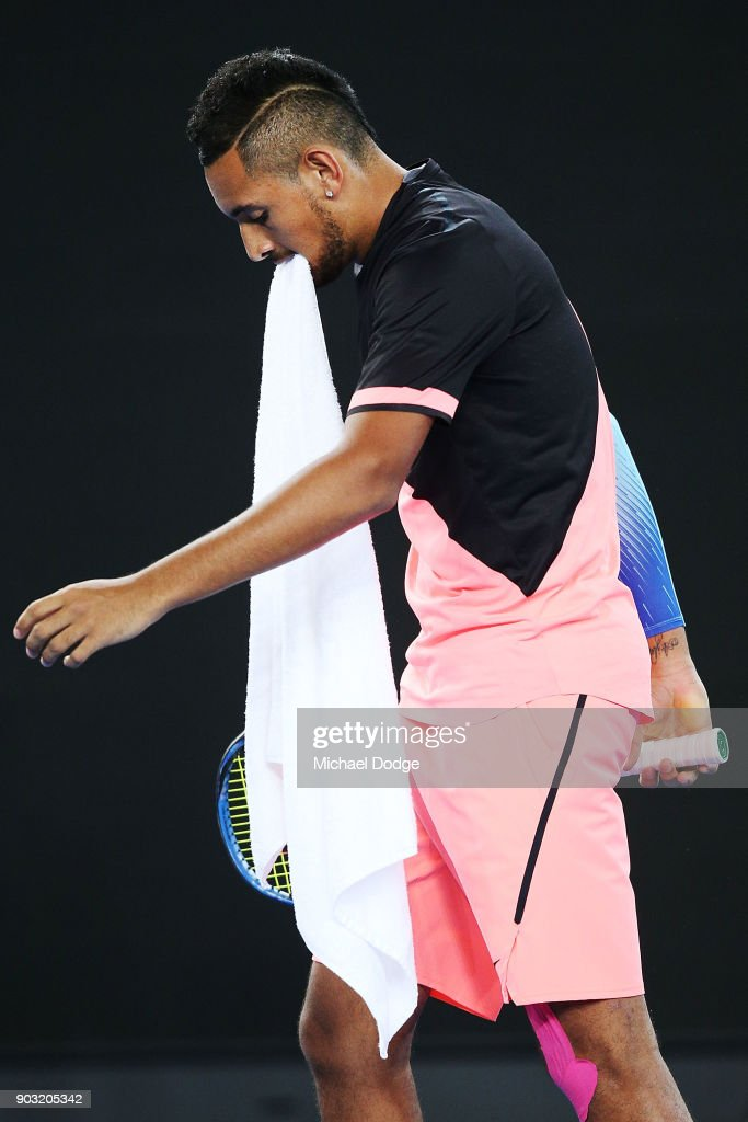 Nick Kyrgios of Australia bites his towel during the Tie Break Tens ahead of the 2018 Australian Open at Margaret Court Arena on January 10, 2018 in Melbourne, Australia.