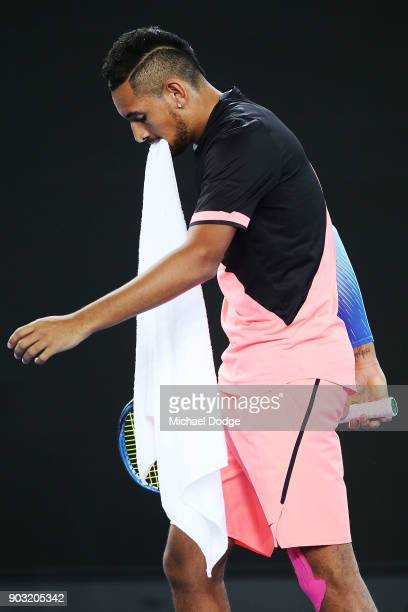 Nick Kyrgios of Australia bites his towel during the Tie Break Tens ahead of the 2018 Australian Open at Margaret Court Arena on January 10 2018 in...
