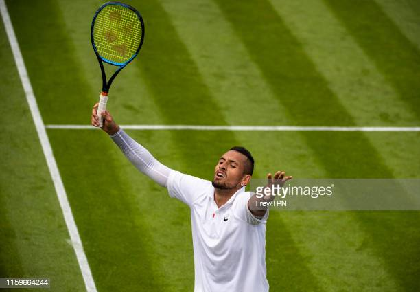 Nick Kyrgios of Australia celebrates after winning the third set against Jordan Thompson of Australia during Day 2 of The Championships Wimbledon...