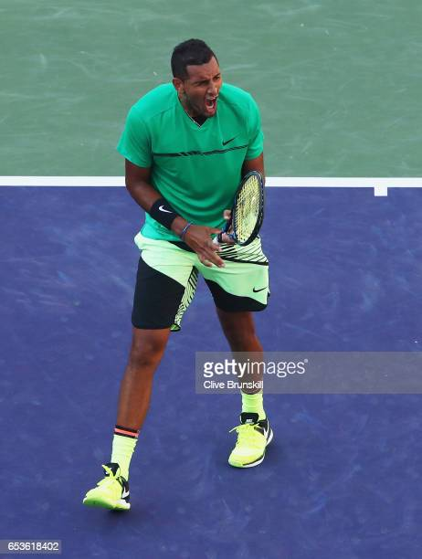 Nick Kyrgios of Australia celebrates match point against Novak Djokovic of Serbia in their fourth round match during day ten of the BNP Paribas Open...
