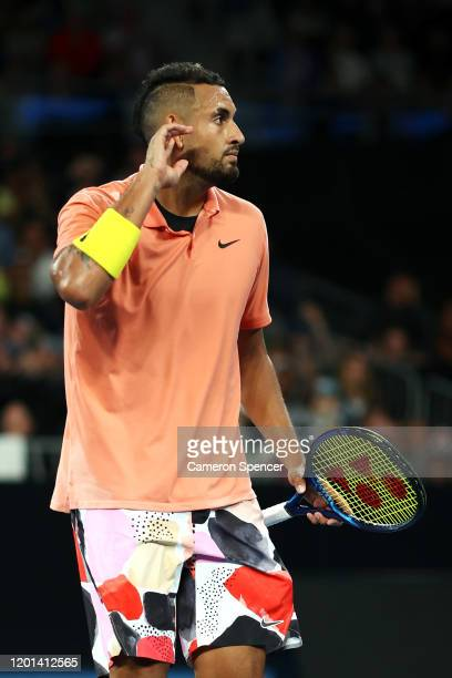 Nick Kyrgios of Australia celebrates reacts to the crowd during his Men's Singles second round match against Gilles Simon of France on day four of...