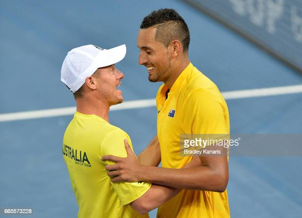 Nick Kyrgios of Australia celebrates victory with Team Captain Lleyton Hewitt after his match against John Isner of the USA during the Davis Cup...