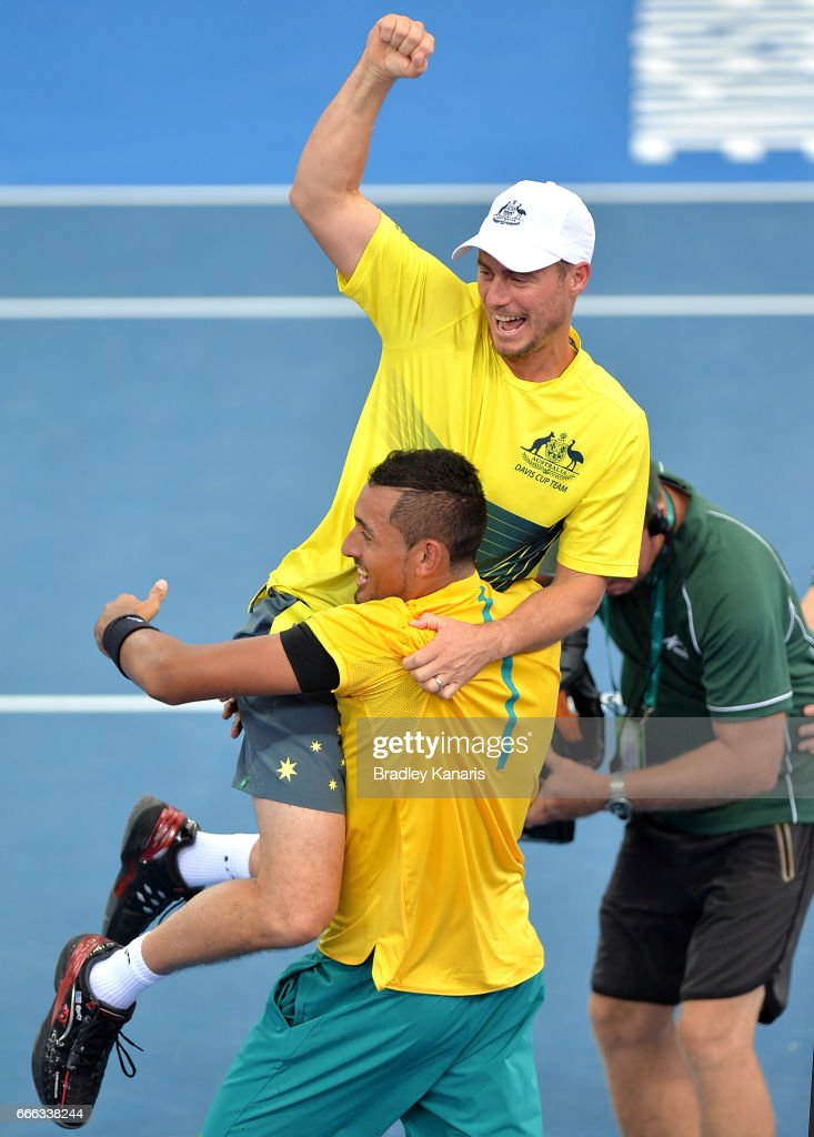 Nick Kyrgios of Australia celebrates victory with Team Captain Lleyton Hewitt after his match against Sam Querrey of the USA during the Davis Cup World Group Quarterfinals between Australia and the USA at Pat Rafter Arena on April 9, 2017 in Brisbane, Australia.