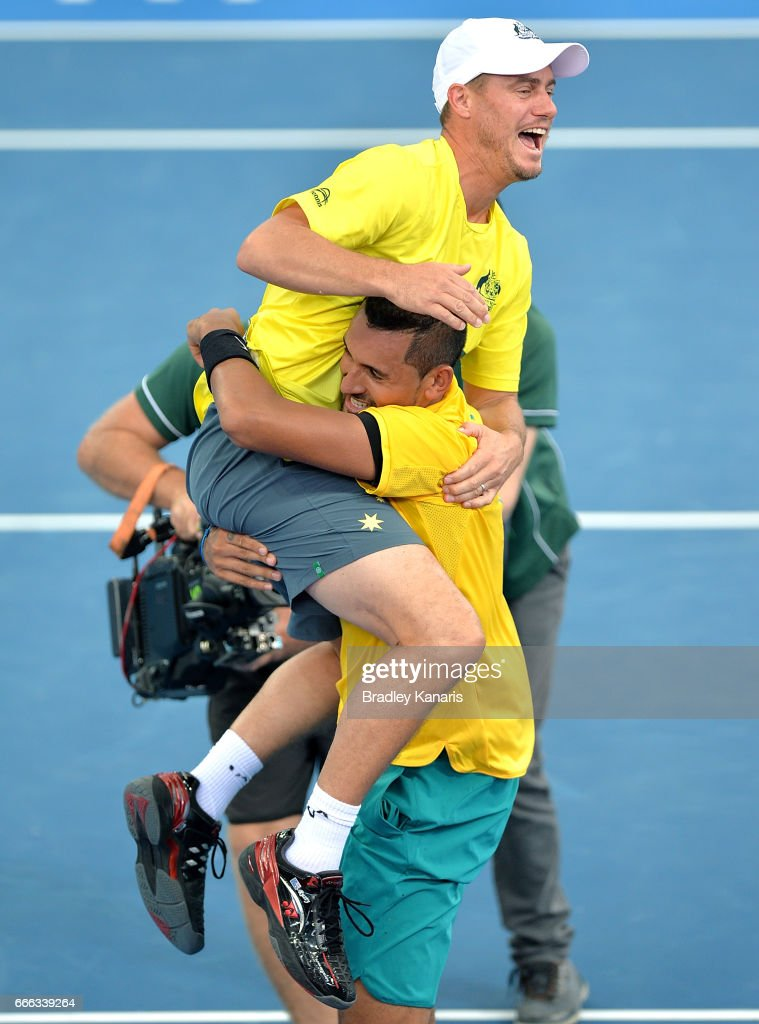 Nick Kyrgios of Australia celebrates victory with Team Captain Lleyton Hewitt of Australia after his match against Sam Querrey of the USA during the Davis Cup World Group Quarterfinals between Australia and the USA at Pat Rafter Arena on April 9, 2017 in Brisbane, Australia.