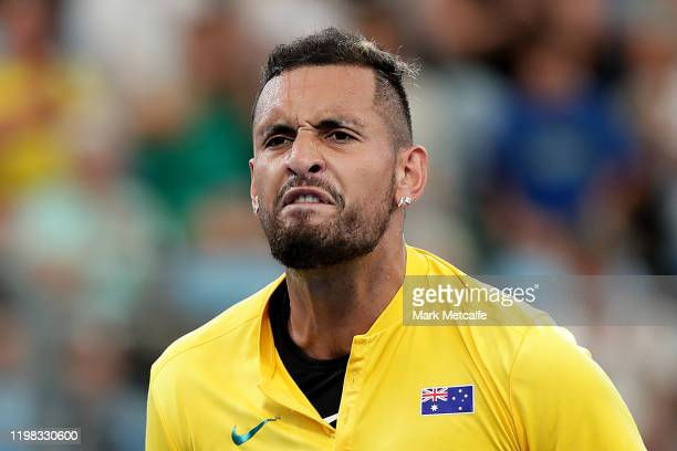 Nick Kyrgios of Australia celebrates winning a point during his quarter final singles match against Cameron Norrie of Great Britain during day seven...