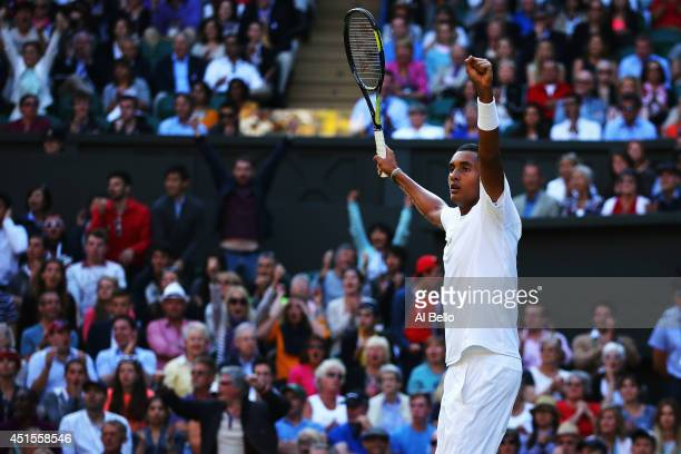 Nick Kyrgios of Australia celebrates winning the third set during his Gentlemen's Singles fourth round match against Rafael Nadal of Spain on day...