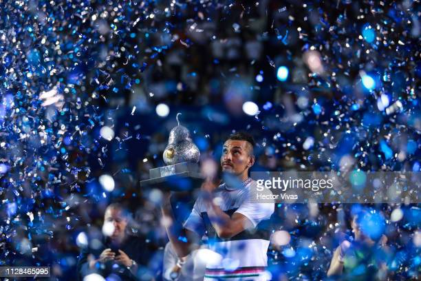 Nick Kyrgios of Australia celebrates with the champion trophy during the final match between Nick Kyrgios of Australia and Alexander Zverev of...