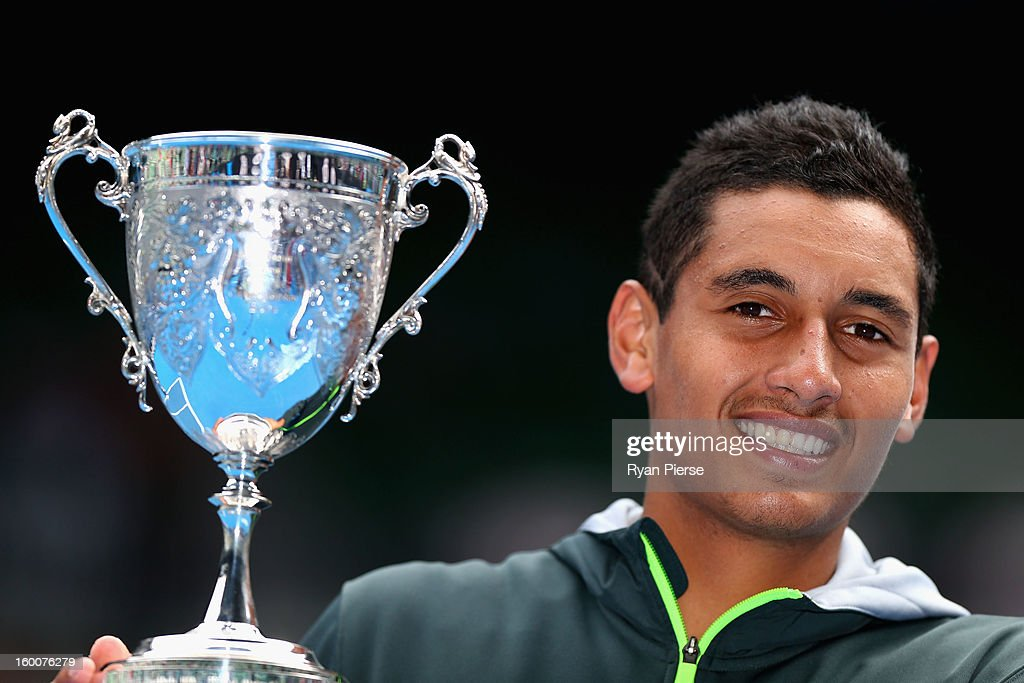 Nick Kyrgios of Australia celebrates with the championship trophy after winning his junior boys' final match against Thanasi Kokkinakis of Australia during the 2013 Australian Open Junior Championships at Melbourne Park on January 26, 2013 in Melbourne, Australia.