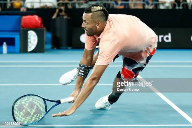Nick Kyrgios of Australia dives to play a forehand during his Men's Singles third round match against Karen Khachanov of Russia on day six of the...