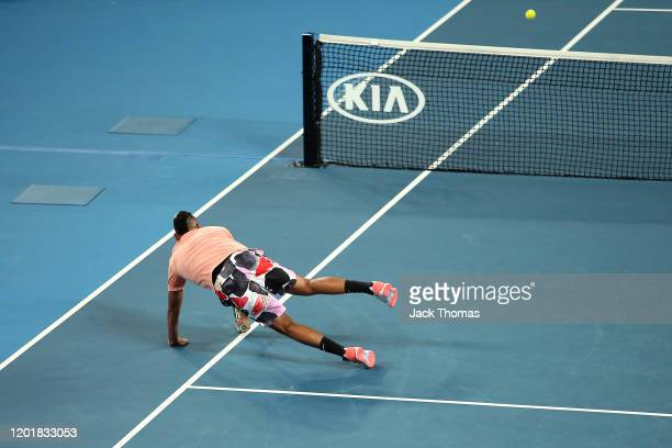 Nick Kyrgios of Australia dives to play a shot during his Men's Singles third round match against Karen Khachanov of Russia on day six of the 2020...