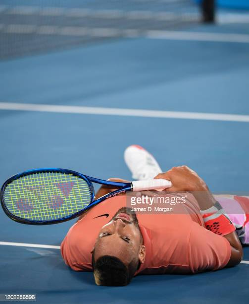 Nick Kyrgios of Australia falls to the floor of Rod Laver Arena during in his fourth round match against Rafael Nadal of Spain on day eight of the...