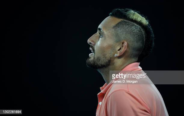 Nick Kyrgios of Australia feels the pain during his fourth round match against Rafael Nadal of Spain on day eight of the 2020 Australian Open at...