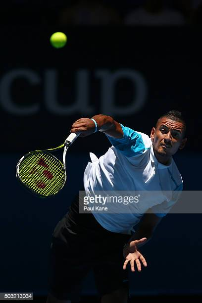 Nick Kyrgios of Australia Green serves to Alexander Zverev of Germany during day one of the 2016 Hopman Cup at Perth Arena on January 3, 2016 in...