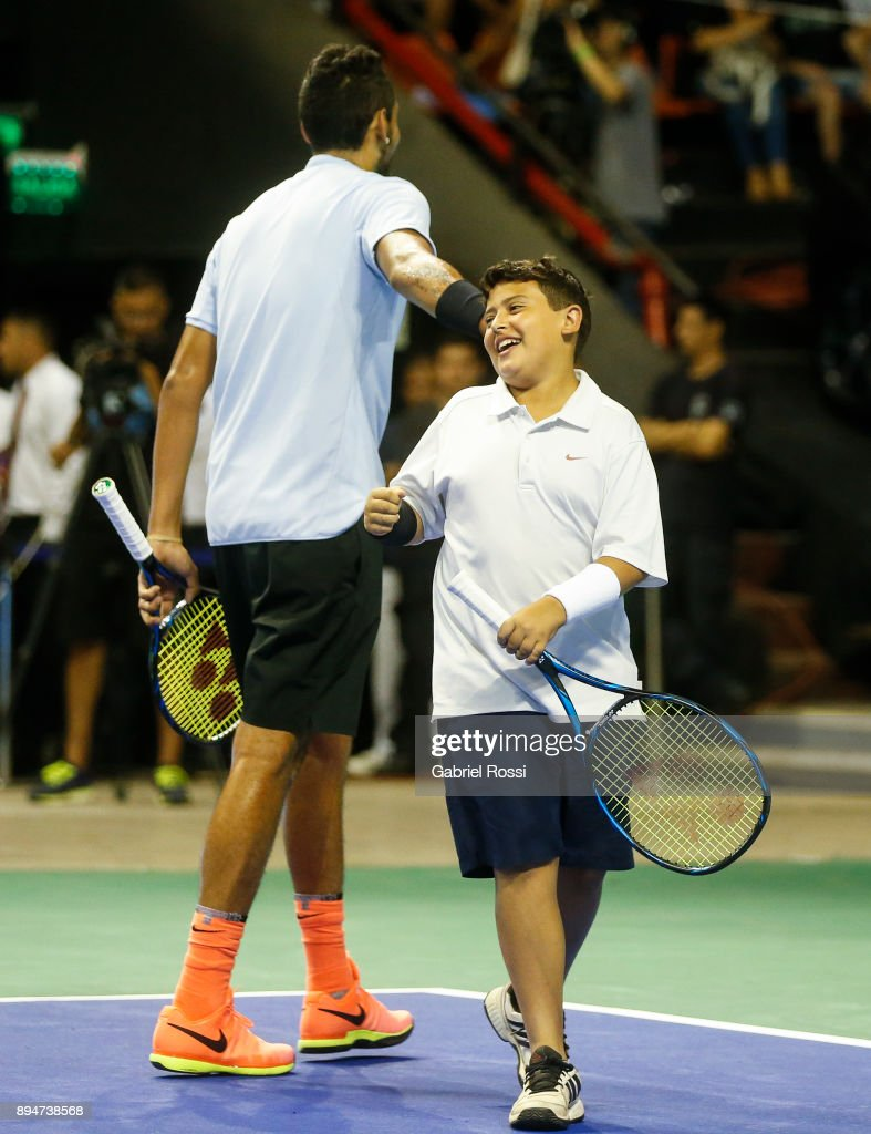 Nick Kyrgios of Australia greets a child during an exhibition match between Juan Martin Del Potro and Nick Kyrgios at Luna Park on December 15, 2017 in Buenos Aires, Argentina.