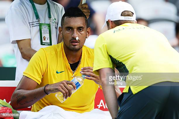 Nick Kyrgios of Australia has his nose plugged by medical staff due to a nose bleed in his singles match against Andrej Martin of Slovakia during the...