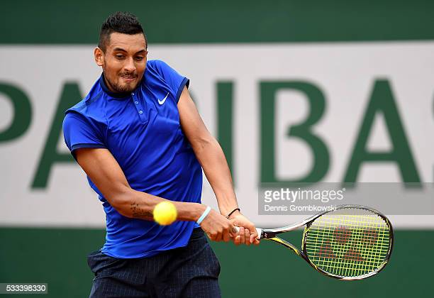 Nick Kyrgios of Australia hits a backhand during the Mens Singles first round match against Marco Cecchinato of Italy on day one of the 2016 French...