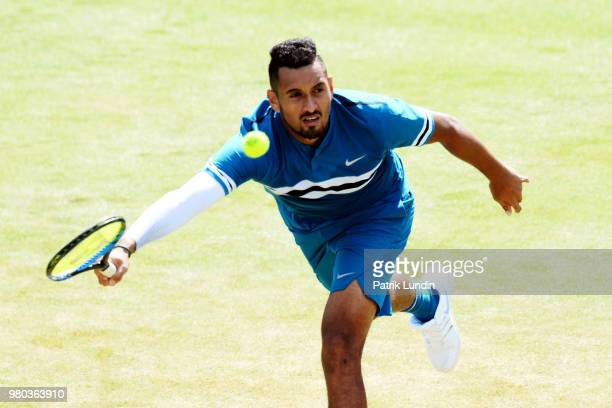 Nick Kyrgios of Australia hits a forehand during the match against Kyle Edmund of Great Britain during Day four of the FeverTree Championships at...