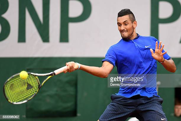 Nick Kyrgios of Australia hits a forehand during the Mens Singles first round match against Marco Cecchinato of Italy on day one of the 2016 French...