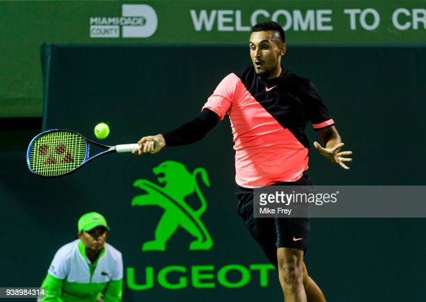 Nick Kyrgios of Australia hits a forehand to Alexander Zverev of Germany during Day 9 of the Miami Open Presented by Itau at Crandon Park Tennis...