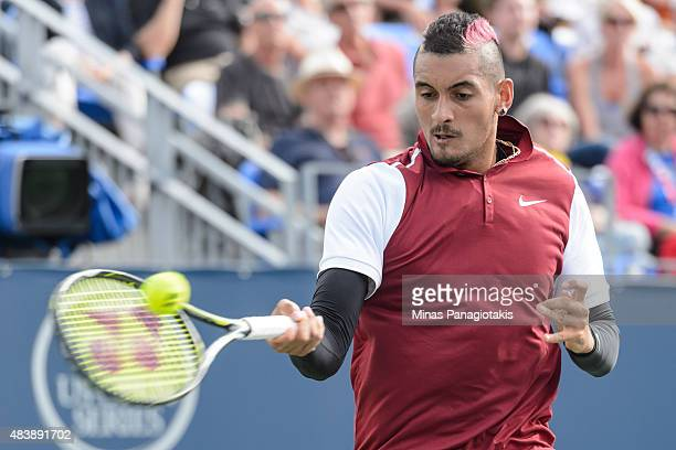 Nick Kyrgios of Australia hits a return against John Isner of the USA during day four of the Rogers Cup at Uniprix Stadium on August 13 2015 in...