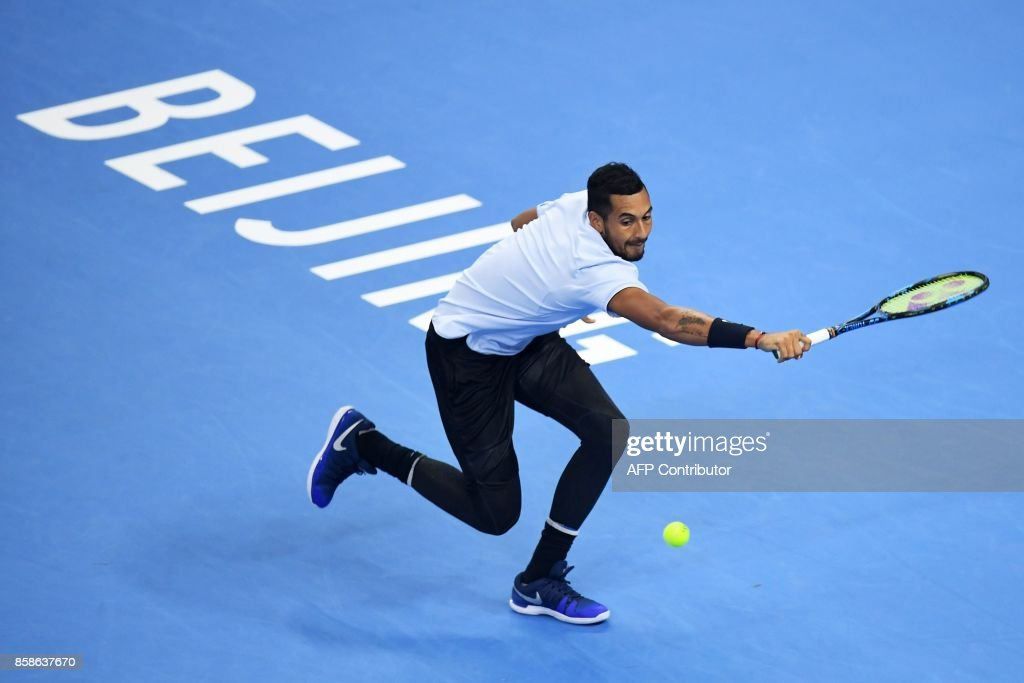 Nick Kyrgios of Australia hits a return during his men's singles semi-final match against Alexander Zverev of Germany at the China Open tennis tournament in Beijing on October 7, 2017 /