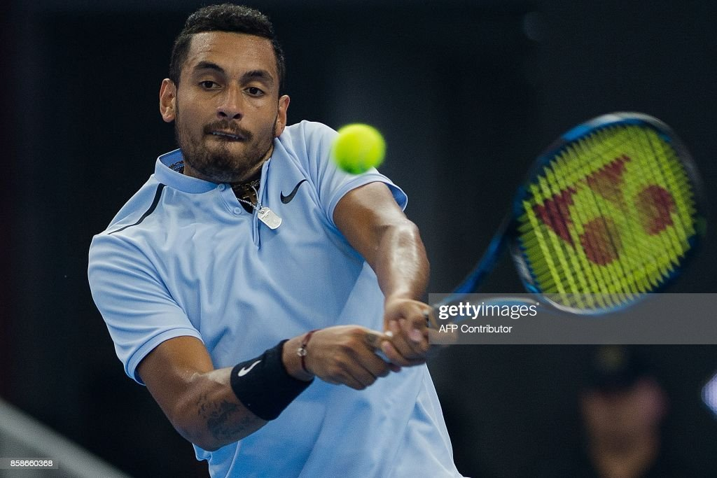 Nick Kyrgios of Australia hits a return during his men's singles semi-final match against Alexander Zverev of Germany at the China Open tennis tournament in Beijing on October 7, 2017. /