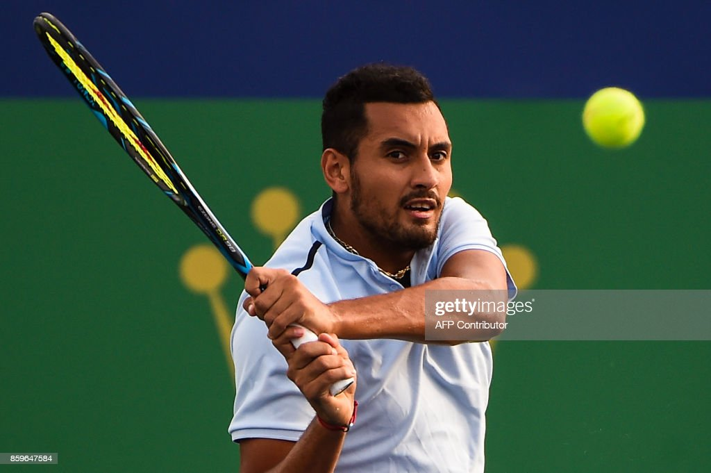 Nick Kyrgios of Australia hits a return during the men's singles against Steve Johnson of America at the Shanghai Masters tennis tournament in Shanghai on October 10, 2017. /