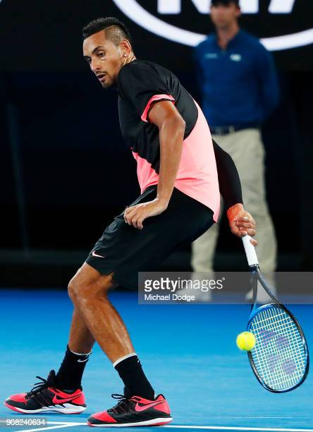 Nick Kyrgios of Australia hits the ball behind his body against Grigor Dimitrov of Bulgaria in his fourth round match against Nick Kyrgios of...