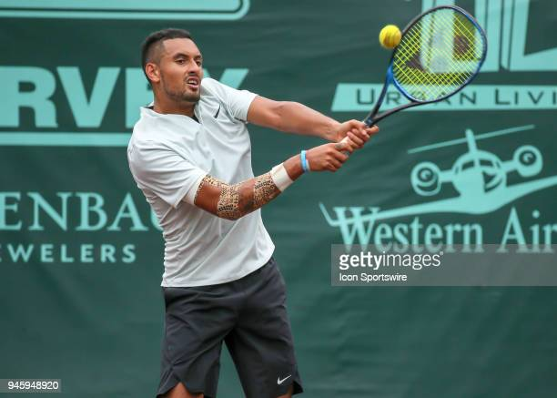 Nick Kyrgios of Australia hits the return in the match against Ivo Karlovic of Croatia during the Quarterfinal round of the Men's Clay Court...