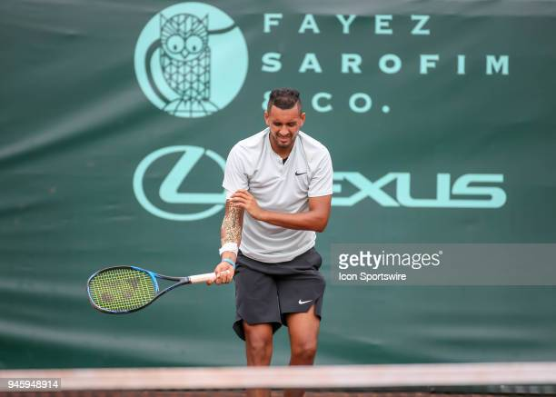 Nick Kyrgios of Australia holds his arm in pain in the match against Ivo Karlovic of Croatia during the Quarterfinal round of the Men's Clay Court...