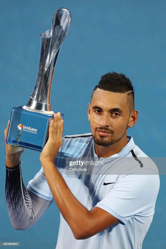 Nick Kyrgios of Australia holds the winners trophy after the Men's Final match against Ryan Harrison of the USA during day eight of the 2018 Brisbane International at Pat Rafter Arena on January 7, 2018 in Brisbane, Australia.