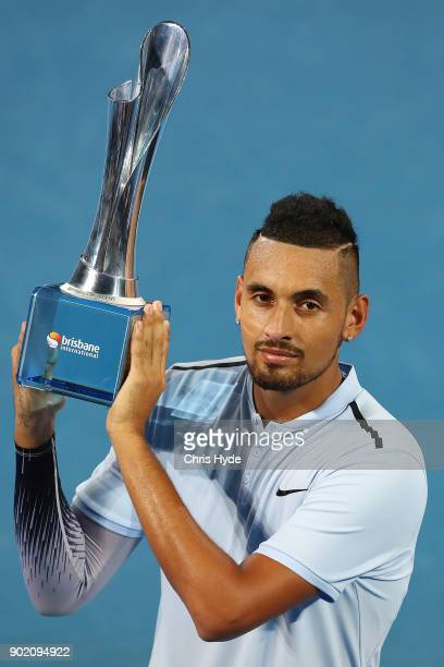 Nick Kyrgios of Australia holds the winners trophy after the Men's Final match against Ryan Harrison of the USA during day eight of the 2018 Brisbane...