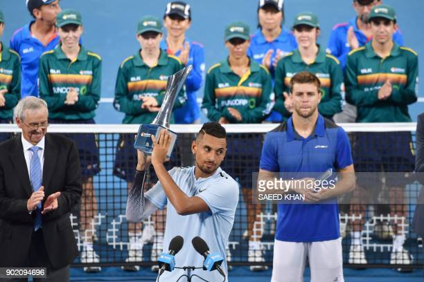 Nick Kyrgios of Australia holds up the trophy after beating Ryan Harrison of the US to win the men's singles final at the Brisbane International...