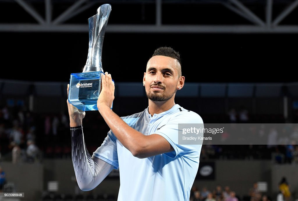 Nick Kyrgios of Australia holds up the winners trophy after winning the Men's Final match against Ryan Harrison of the USA during day eight of the 2018 Brisbane International at Pat Rafter Arena on January 7, 2018 in Brisbane, Australia.