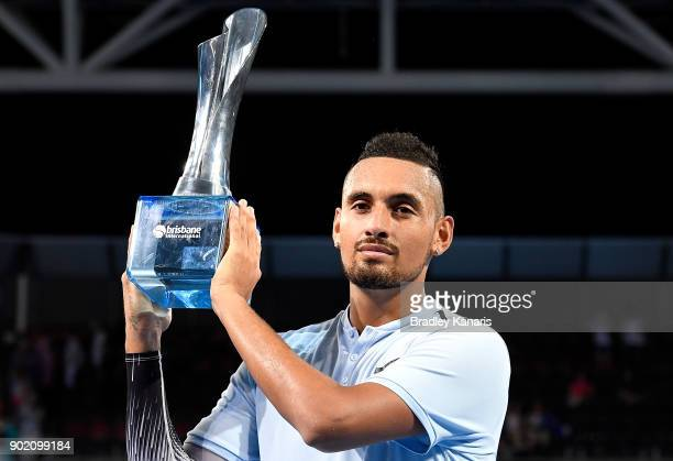 Nick Kyrgios of Australia holds up the winners trophy after winning the Men's Final match against Ryan Harrison of the USA during day eight of the...
