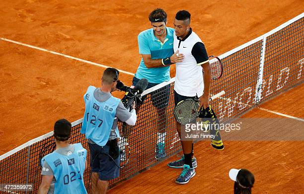 Nick Kyrgios of Australia is congratulated by Roger Federer of Switzerland afte his 3 sets win during day five of the Mutua Madrid Open tennis...