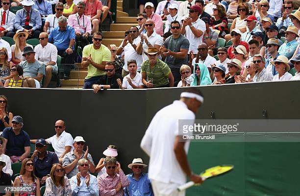 Nick Kyrgios of Australia is encouraged by his coaching team during his Gentlemen's Singles Third Round match against Milos Raonic of Canada during...