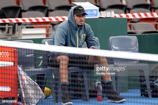 Nick Kyrgios of Australia is seen watching on during practice ahead of the Davis Cup World Group Quarterfinal match between Australia and the USA at...