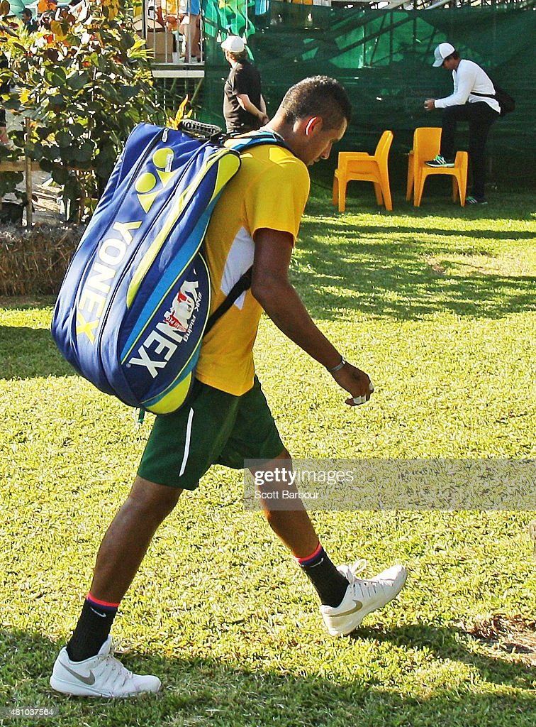 Nick Kyrgios of Australia leaves the arena after losing his match against Aleksandr Nedovyesov of Kazakhstan as Pat Rafter (R) looks on during day one of the Davis Cup World Group quarterfinal tie between Australia and Kazakhstan at Marrara Sporting Complex on July 17, 2015 in Darwin, Australia.