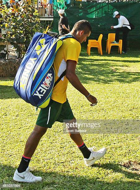 Nick Kyrgios of Australia leaves the arena after losing his match against Aleksandr Nedovyesov of Kazakhstan as Pat Rafter looks on during day one of...
