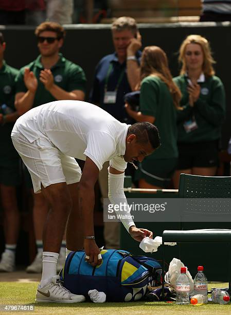 Nick Kyrgios of Australia leaves the court after defeat in his Gentlemen's Singles Fourth Round match against Richard Gasquet of France during day...