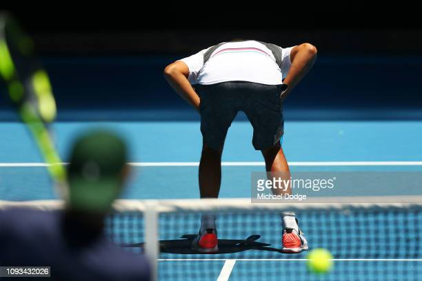 Nick Kyrgios of Australia lets his hitting partner take aim at him during a practice session ahead of the 2019 Australian Open at Melbourne Park on...