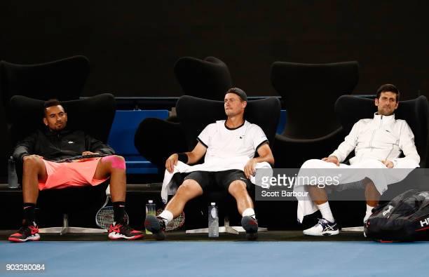 Nick Kyrgios of Australia Lleyton Hewitt of Australia and Novak Djokovic of Serbia look on during the Tie Break Tens ahead of the 2018 Australian...