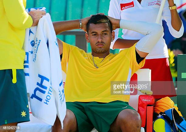 Nick Kyrgios of Australia looks on as he sits in his chair in between games in his match against Aleksandr Nedovyesov of Kazakhstan during day one of...