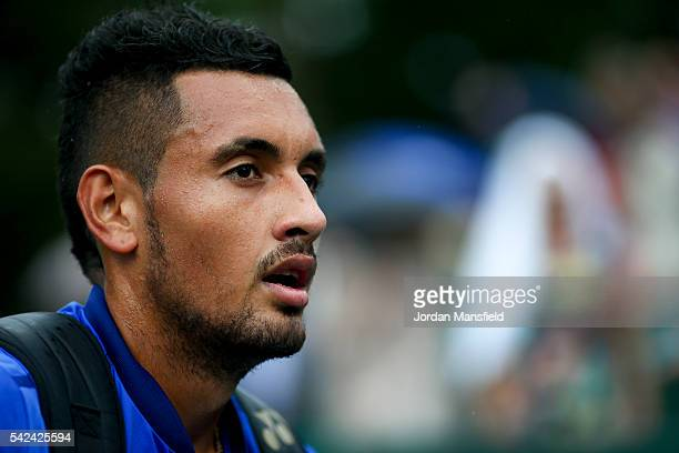 Nick Kyrgios of Australia looks on as he walks off court as rain delays his match with Juan Monaco of Argentina during day three of The Boodles...
